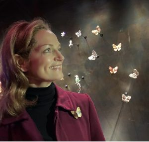 Mara Hotung, Gem Voyager looking at butterfly jewels