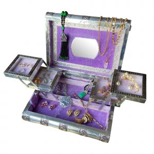 Silver jewellery box with purple lining and old jewellery